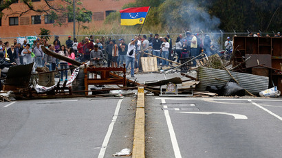 Supporters of opposition leader Leopoldo Lopez stand at a barricade during a protest against President Nicolas Maduro's government, in a middle-class neighbourhood in Caracas February 20, 2014.(Reuters / Carlos Garcia Rawlins )