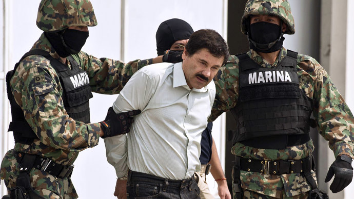 "Mexican drug trafficker Joaquin Guzman Loera aka ""el Chapo Guzman"" (C), is escorted by marines as he is presented to the press on February 22, 2014 in Mexico City. (AFP Photo / Ronaldo Schemidt)"