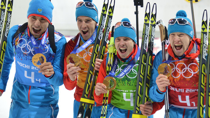 Gold medalists Russia's Anton Shipulin, Dmitry Malyshko, Evgeny Ustyugov and Russia's Alexey Volkov celebrate at the podium in the Men's Biathlon 4x7.5 km Relay Medal Ceremony at the Laura Cross-Country and Biathlon Center during the Sochi Winter Olympics on February 22, 2014, in Rosa Khutor, in Sochi. (AFP Photo / Alberto Pizzoli)