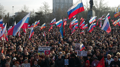 People wave Russian flags as they protest in the center of the southern Ukrainian city of Sevastopol, the main base of the Russian Black Sea Fleet, on February 23, 2014 (AFP Photo / Vasily Batanov)