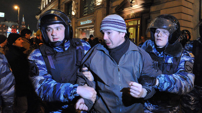 Policemen detain a participant in a protest action of supporters of the persons involved in the Bolotnaya Square case in Manezhnaya Square. (RIA Novosti/Sergey Kuznecov)