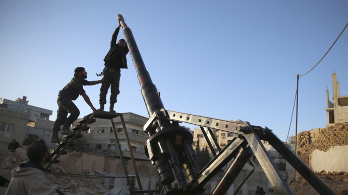 Fighters from the Free Syrian Army's Saad Bin Obada al-Khazerji brigade, al-Rahman corps, prepare to fire an artillery cannon in eastern al-Ghouta, targeting forces loyal to Syria's President Bashar al-Assad based in the capital Damascus January 29, 2014. (Reuters/Mohammed Abdullah)