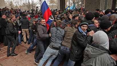 Russian flag over Crimea's parliament as people barricaded inside
