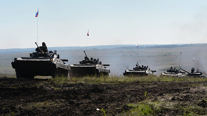 A Russian column of tracked armored vehicles (RIA Novosti / Pavel Lisitsyn)