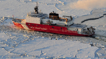 U.S. Coast Guard cutter Healy cuts through ice on their way to the Alaskan port of Nome (Reuters/U.S. Coast Guard/Charly Hengen)