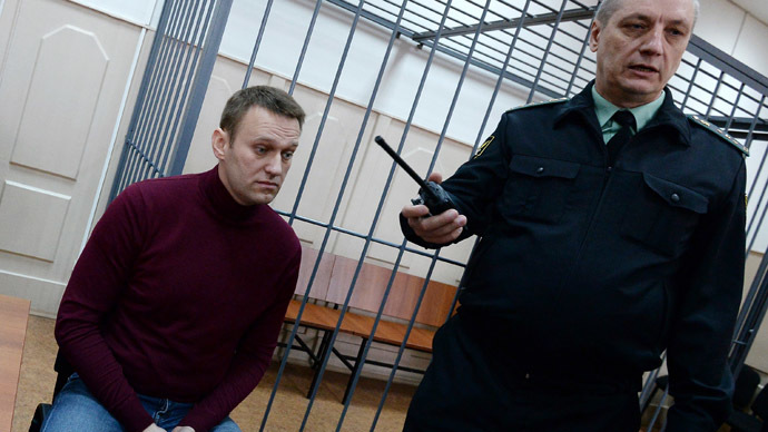 Aleksey Navalny (left) in the Basmanny District Court in Moscow. (RIA Novosti/Maksim Blinov)