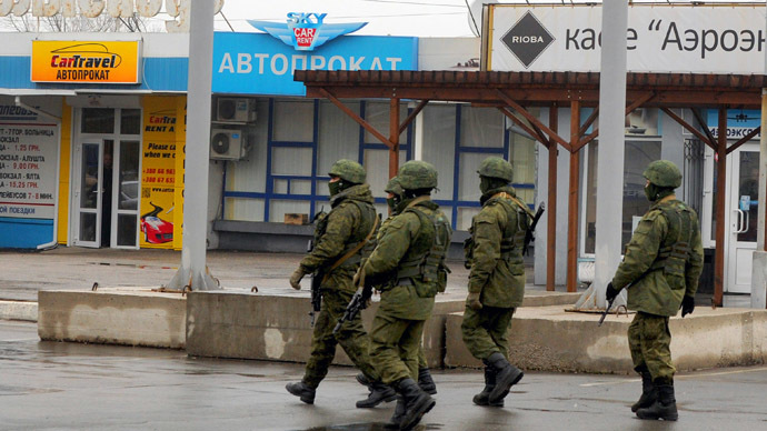 Armed 'self-defense squads' patrol outside of Simferopol airport, on February 28, 2014. (AFP Photo/Viktor Drachev)