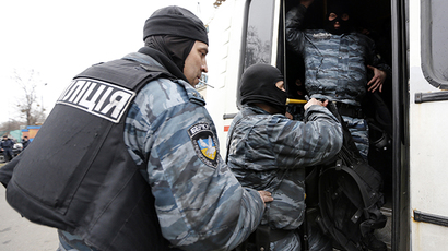 Members of Berkut anti-riot unit embark in a bus as leave their barracks in Kiev February 22, 2014. (Reuters / Yannis Behrakis)