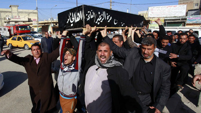 Mourners carry the coffin of a victim who was killed in a mortar attack, during a funeral in Mussayab, 60km (40 miles) south of the capital Baghdad, February 21, 2014. (Reuters/Alaa Al-Marjani)