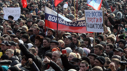 "Pro-Russian protesters hold a banner (C) reading ""Donetsk region with Russia"" and a placard reading ""South-east against fascism!"" during a rally in the industrial Ukrainian city of Donetsk on March 1, 2014. (AFP Photo/Alexander Khudoteply)"