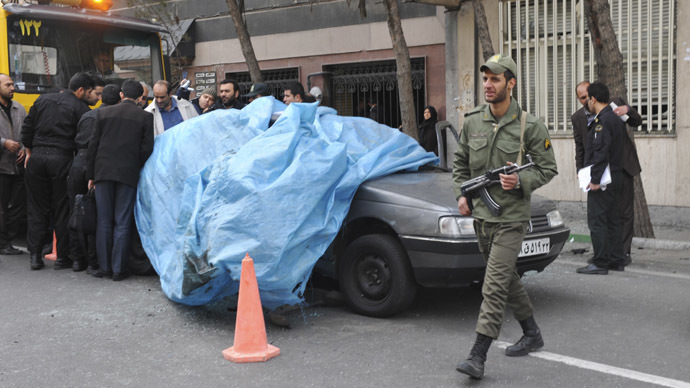 A policeman walks past the car belonging to Iranian nuclear scientist Mostafa Ahmadi-Roshan at a blast site outside a university in northern Tehran January 11, 2012. (Reuters/IIPA/Sajad Safari)