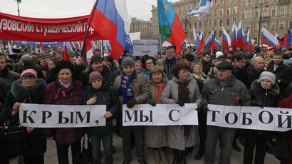 "The participants of the Saint Petersburg rally in support of Russian-speakers in Ukraine carry a banner saying: ""Crimea, we are with you."" (RIA Novosti/Igor Russak)"
