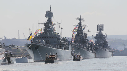 Ukrainian frigate The Hetman Sagaidachny, left, in the formation of Russian Black Sea Fleet ships at a parade on Russian Navy Day in Sevastopol. (RIA Novosti/Alexey Kudenko)