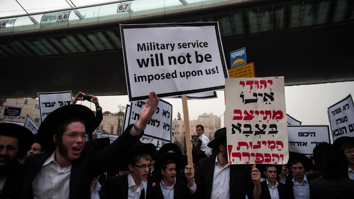 "Ultra-Orthodox Jews holding a placard that reads in english ""Military service will not be imposed upon us"" take part in a mass prayer vigil in Jerusalem on March 2, 2014.(AFP Photo / David Buimovitch)"
