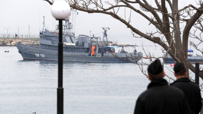 Ukrainian marines look at a Russian ship floating out of the Sevastopol bay on March 4, 2014 (AFP Photo / Viktor Drachev)