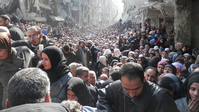 Residents wait to receive food aid distributed by the U.N. Relief and Works Agency (UNRWA) at the besieged al-Yarmouk camp, south of Damascus on January 31, 2014, in this handout picture made available to Reuters February 26, 2014 (Reuters)