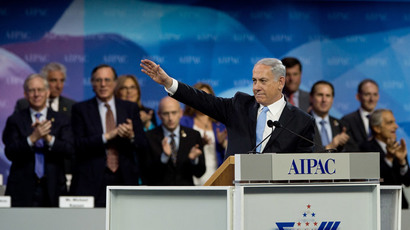 Israeli Prime Minister Benjamin Netanyahu waves after addressing the Israel Public Affairs Committee (AIPAC) policy conference in Washington on March 4, 2014.(AFP Photo / Nicholas Kamm)