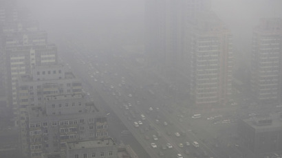 Cars drive on the Three Ring Road amid the heavy haze in Beijing (Reuters/Jason Lee)