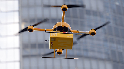 A quadrocopter drone controlled remotely transports a post package during a test flight. (AFP Photo / Patrick Stollarz)