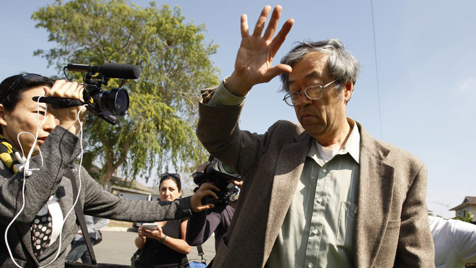 A man widely believed to be Bitcoin currency founder Satoshi Nakamoto is surrounded by reporters as he leaves his home in Temple City, California March 6, 2014. (Reuters/David McNew)