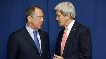 Russia's Foreign Minister Sergei Lavrov (L) and US Secretary of State John Kerry meet to discuss the Ukraine crisis on the sidelines of an International conference on Libya in Rome on March 6, 2014. (AFP Photo / Kevin Lamarque)