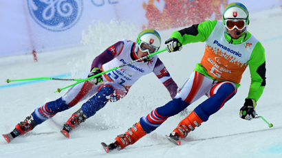 Slovakia's Miroslav Haraus (L) and his guide Maros Hudik (R) compete during the Men's Downhill Visually Impraired at the XI Paralympic Olympic games, in the Rosa Khutor stadium, near Sochi, on March 8, 2014 (AFP Photo / Kirill Kudryavtsev)