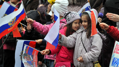 Children wave Russian flags during a mass pro-Russian rally in the center of Sevastopol, on March 8, 2014.(AFP Photo / Viktor Drachev)