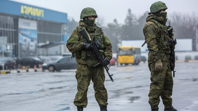 Armed people outside Simferopol airport in the Crimea. (RIA Novosti/Andrey Stenin)