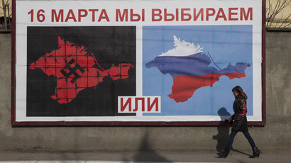 A woman walking by a poster calling people to vote in the upcoming referendum, in the Crimean port city of Sevastopol (Reuters / Baz Ratner)