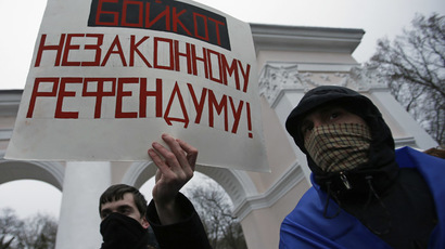A man holds an anti-referendum poster in Simferopol on March 11, 2014. (Reuters/David Mdzinarishvili)