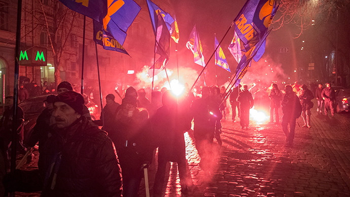 ARCHIVE PHOTO: Activists of the Svoboda (Freedom) Ukrainian nationalist party hold torches as they take part in a rally to mark the 105th year since the birth of Stepan Bandera, one of the founders of the Organization of Ukrainian Nationalists (OUN), in Kiev January 1, 2014 (Reuters / Gleb Garanich)