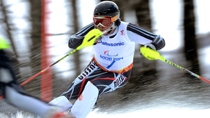 Russia's Valerii Redkozubov (B2) competes in the men's Alpine Skiing Slalom Visually Impaired event during the XI Paralympic winter games at the Rosa Khutor Alpine Center close to the city of Sochi on March 13, 2014. (AFP Photo)
