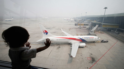 A boy looks out a window overlooking the haze-covered Kuala Lumpur International Airport in Sepang, outside Kuala Lumpur June 24, 2013.(Reuters / Bazuki Muhammad )