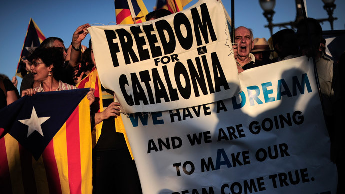 Demonstrators take part in a protest as part of a campaign for independence from Spain (AFP Photo / Josep Lago)