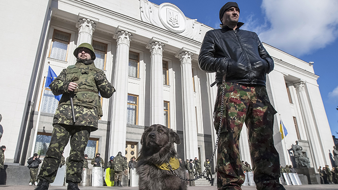 "Members of a ""Maidan"" self-defense unit stand guard in front of a Ukrainian parliament building in Kiev March 17, 2014. (Reuters / Alex Kuzmin)"