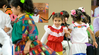 File photo. Students perform a dance during an Hispanic Heritage event (AFP Photo / Saul Loeb)