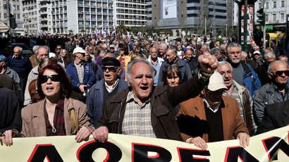 Greek pensioners march in central Athens calling for free and public health system, on March 20, 2014, on a second day of a 48-hour strike against new layoffs. (AFP Photo/ Louisa Gouliamaki)