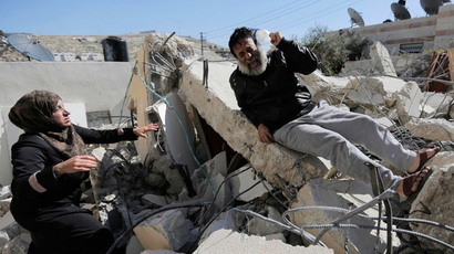A Palestinian man reacts as he sits atop rubble after his home was demolished in Jabel Mukaber, a village in the suburbs of East Jerusalem (Reuters / Ammar Awad)