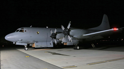 A Royal Australian Air Force AP-3C Orion sits on the tarmac in preparation for a flight to search for missing Malaysia Airlines flight MH370 in the southern Indian Ocean, at Pearce Air Force base in Bullsbrook, 35 kms north of Perth, on March 22, 2014 (AFP Photo / Rob Griffith)