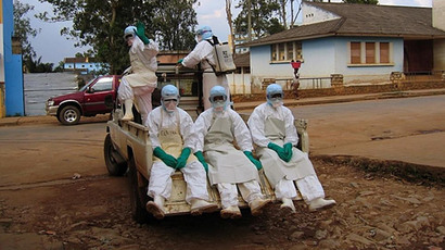 "Health workers, dressed in head-to-toe ""Ebola suits"", leaving in a pick-up truck in Uige, about 300km north of the Angolan capital, Luanda, to collect a man dying from haemorrhagic fever. (AFP Photo / Florence Panoussian)"