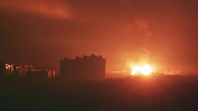 An explosion followed by a huge fire rages in the south-west part of Pristina in the early hours March 25, 1999 after NATO forces launched a missile attack against Yugoslavia (Reuters / Yannis Behrakis)