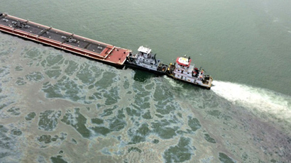 barge loaded with marine fuel oil sits partially submerged in the Houston Ship Channel in this U.S. Coast Guard picture taken March 22, 2014 (Reuters / US Coast Guard)