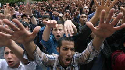 Egyptian students from Cairo University, supporters of ousted Islamist president Mohamed Morsi, demonstrate inside the grounds of their campus in the capital Cairo, on March 19, 2014. (AFP Photo/Mohamed El-Shahed)