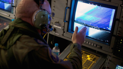 A crewman of a Royal Australian Air Force (RAAF) AP-3C Orion aircraft looks at a screen while searching for the missing Malaysian Airlines Flight MH370 over the southern Indian Ocean March 24, 2014. (Reuters/Richard Wainwright)