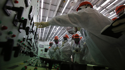 Tokyo Electric Power Co. (TEPCO) employees wearing protective suits and masks visit inside the central control room for the Number 1 and Number 2 reactors at TEPCO's tsunami-crippled Daiichi nuclear power plant in Fukushima prefecture (AFP Photo / Toru Hanai)