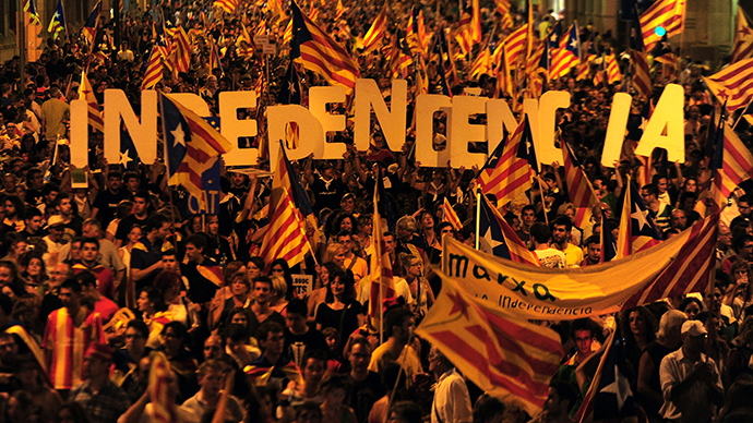 (FILES) A picture taken on September 11, 2012 shows supporters of independence for Catalonia demonstrating in Barcelona (AFP Photo / Lluis Gene)