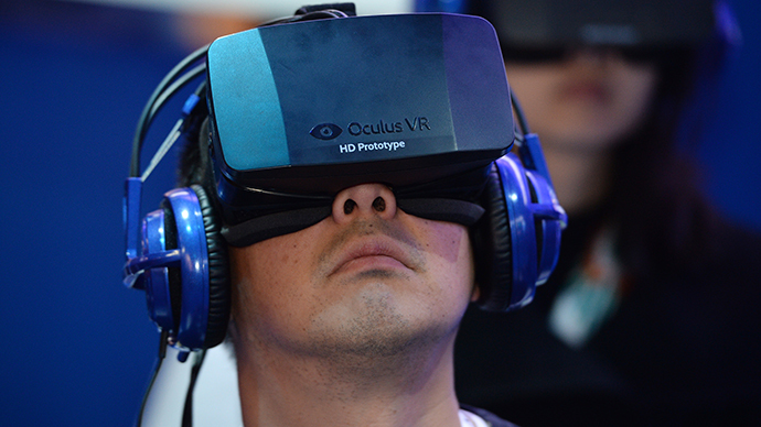 An attendee wears an Oculus Rift HD virtual reality head-mounted display (AFP Photo / Robyn Beck)