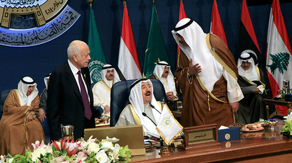 Kuwaiti Foreign Minister Sheikh Sabah al-Khaled al-Sabah (R) and Secretary General of the Arab League Nabil al-Araby (L) speak to the Emir of Kuwait Sheikh Sabah al-Ahmad al-Jaber al-Sabah during the 25th Arab League summit at Bayan palace in Kuwait City on March 26, 2014 (AFP Photo / Yasser Al-Zayyat)