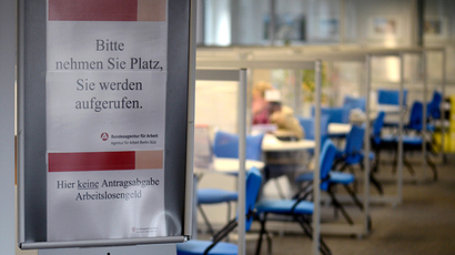 "sign tell visitors to wait to be called, as a job seeker is seen speaking with an advisor at the unemployment centre ""Agentur fuer Arbeit"" (AFP Photo)"
