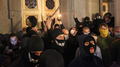 Nationalists from the Right Sector movement gather outside the parliament building to demand the immediate resignation of Internal Affairs Minister Arsen Avakov, in Kiev March 27, 2014. (Reuters / Vasily Fedosenko)